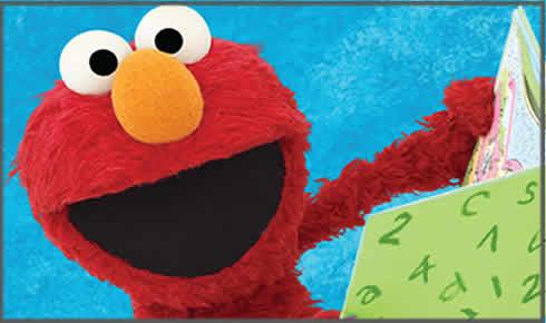 Elmo reading a book