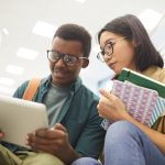 Boy and girl teen reading on a tablet